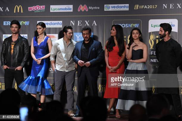 Bollywood actors Sushant Singh Rajput Kriti Sanon Varun Dhawan Salman Khan Katrina Kaif Alia Bhatt and Shahid Kapoor pose during a press conference...
