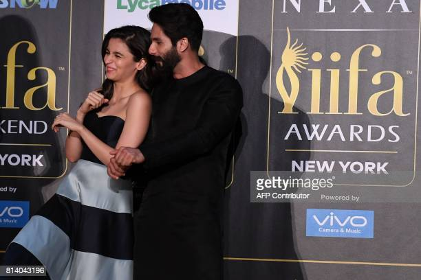 Bollywood actress Alia Bhatt and actor Shahid Kapoor dance during a press conference ahead of the 18th International Indian Film Academy Festival in...