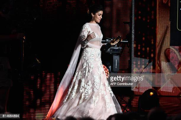 Bollywood actress Alia Bhatt arrives on stage to give an award during IIFA Rocks July 14 2017 at the MetLife Stadium in East Rutherford New Jersey...