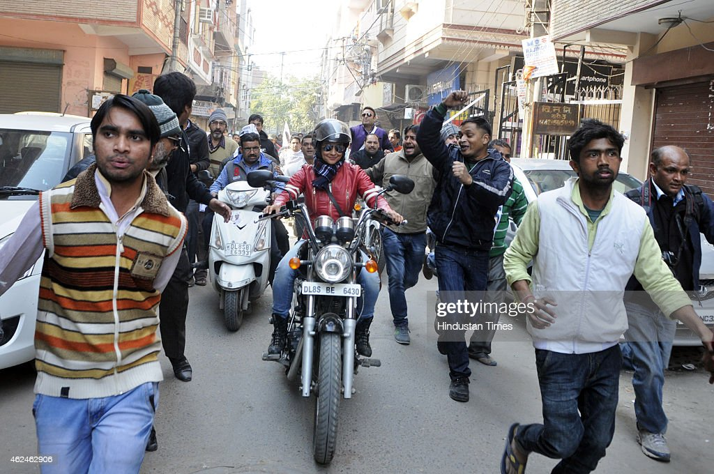 Bollywood actress and AAP leader Gul Panag rides bike during election campaign for the party candidate at Shashtri Nagar area for the coming Delhi Assembly elections 2015 on January 29, 2015 in New Delhi, India. Polling in Delhi will be held on February 7 and the counting of votes will take place on February 10.