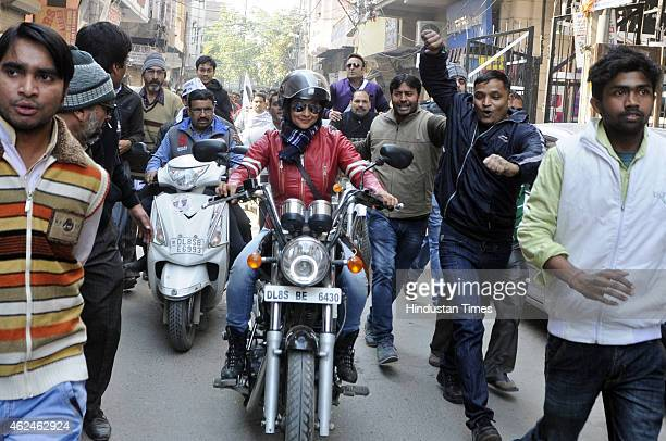 Bollywood actress and AAP leader Gul Panag rides bike during election campaign for the party candidate at Shashtri Nagar area for the upcoming Delhi...