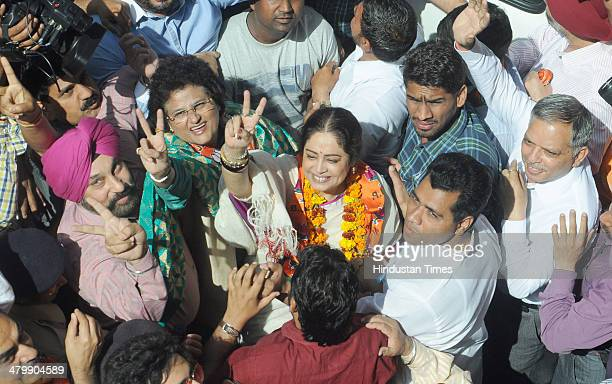 Bollywood actress and BJP candidate from Chandigarh Kirron Kher along with her supporter after filling the nomination papers for the forthcoming Lok...
