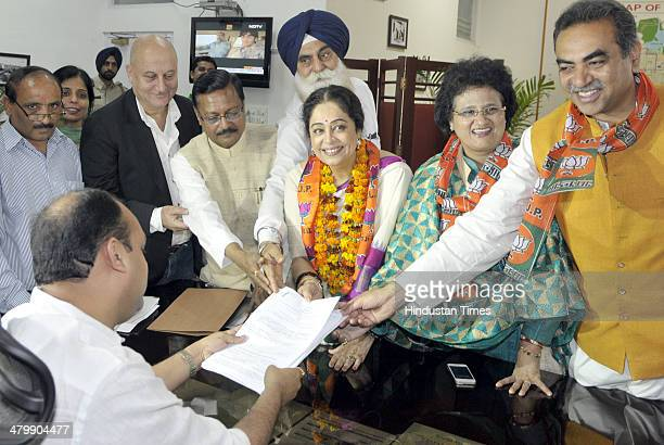 Bollywood actress and BJP candidate from Chandigarh Kirron Kher was accompanied by her actor husband Anupam Kher local BJP President Sanjay Tandon...