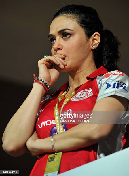 Bollywood actress and Kings XI Punjab coowner Preity Zinta spends tense moments watching her team play during the IPL Twenty20 cricket match between...
