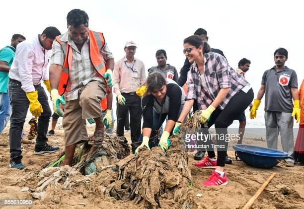 Bollywood actress Anushka Sharma along with BMC officials and workers cleans up Versova Beach on September 29 2017 in Mumbai India