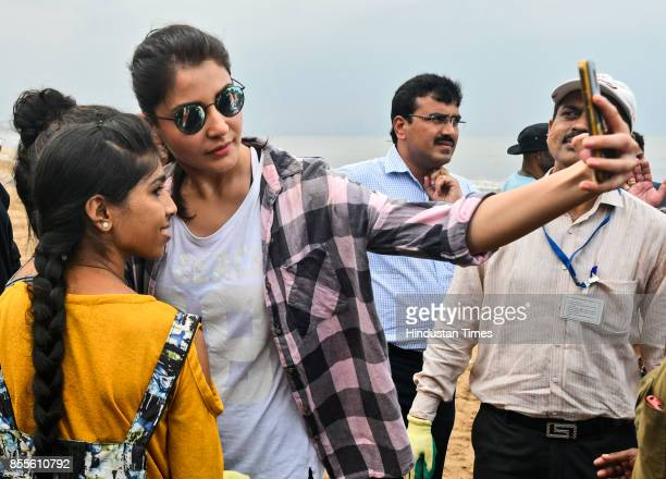Bollywood actress Anushka Sharma along wth BMC officials and workers cleans up Versova Beach on September 29 2017 in Mumbai India