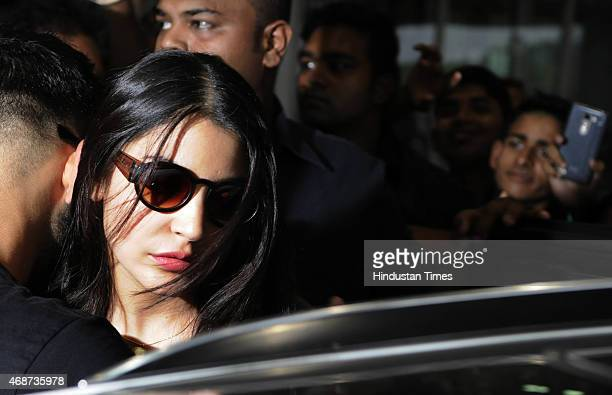 Bollywood actress Anushka Sharma arrive with her boyfriend and Indian cricketer Virat Kohli at NSCBIA Dum Dum Airport on April 6 2015 in Kolkata...