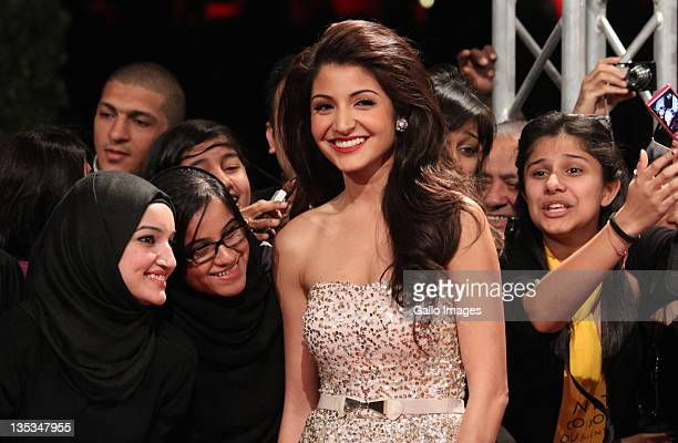 Bollywood actress Anushka Sharma poses with fans on the red carpet during the 2011 Dubai International Film Festival on December 8 2011 in Dubai...