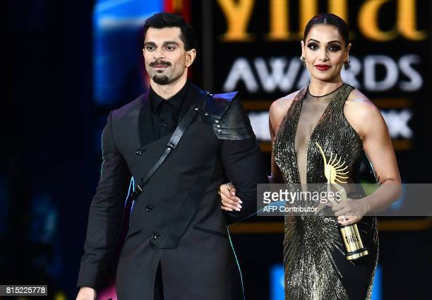 Bollywood actress Bipasha Basu and her husand Karan Singh Grover arrive on stage during the 18th International Indian Film Academy Festival at the...