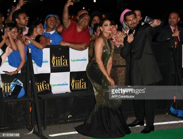 Bollywood Actress Bipasha Basu poses for selfies with Karan Singh for the IIFA Awards July 15 2017 at the MetLife Stadium in East Rutherford New...