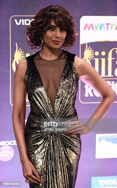 Bollywood actress Bipasha Basu poses on the green carpet at the Tampa Convention Center ahead of IIFA Rocks on the second day of the 15th...