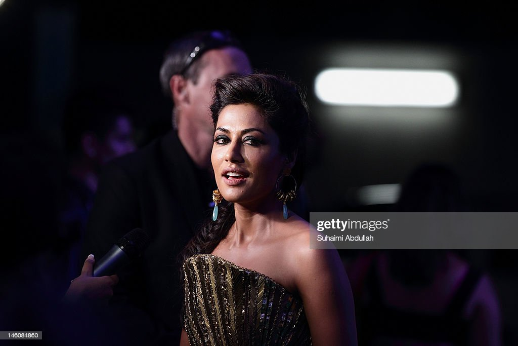 Bollywood actress Chitrangada Singh poses at the IIFA awards green carpet event at the 2012 International India Film Academy Awards at the Singapore Indoor Stadium on June 9, 2012 in Singapore.