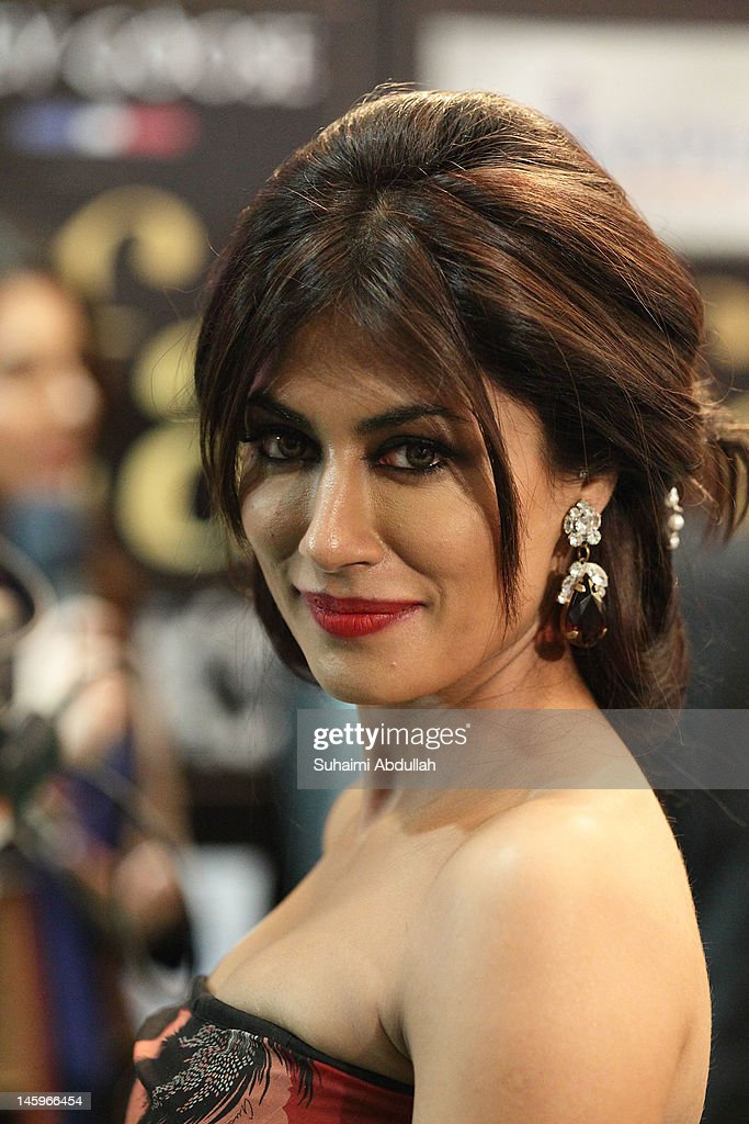 Bollywood actress Chitrangada Singh poses on the green carpet during the IIFA Rocks Green Carpet on day two of the 2012 International India Film Academy Award weekend at the Esplanade on June 8, 2012 in Singapore.