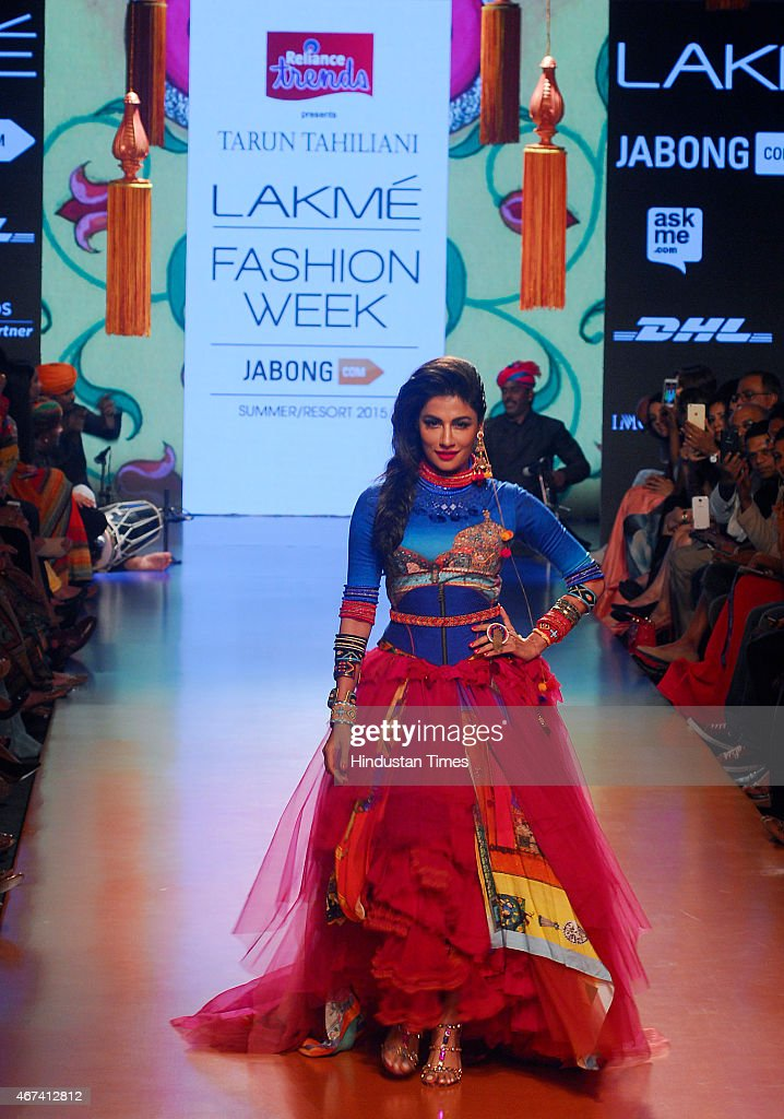 Bollywood actress Chitrangada Singh walks the ramp displaying an outfit by designer Tarun Tahiliani, during the Lakme Fashion Week Summer/Resort 2015 on March 22, 2015 in Mumbai, India.