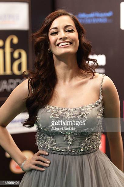 Bollywood actress Dia Mirza poses on the green carpet during the IIFA Rocks Green Carpet on day two of the 2012 International India Film Academy...