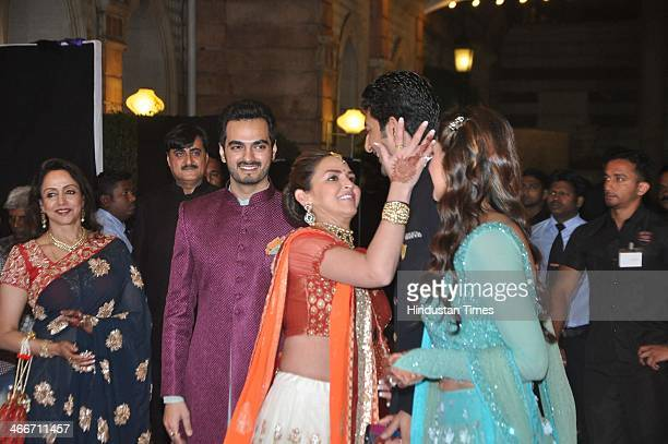 Bollywood actress Esha Deol along with her husband Bharat Takhtani gives a loving pat on her brotherinlaw Vaibhav Vohras cheek as sister Ahana and...
