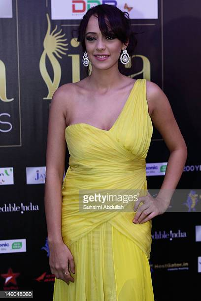 Bollywood actress Hazel Keech poses at the IIFA green carpet event at the 2012 International India Film Academy Awards at the Singapore Indoor...