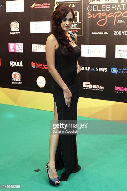 Bollywood actress Hazel Keech poses on the green carpet during the IIFA Rocks Green Carpet on day two of the 2012 International India Film Academy...