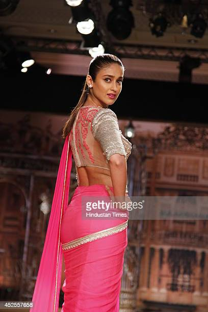 Bollywood actress Ileana D'Cruz walked the ramp for designer Sulakshana Monga on the last day Shree Raj Mahal Jewellers India Couture Week 2014 held...