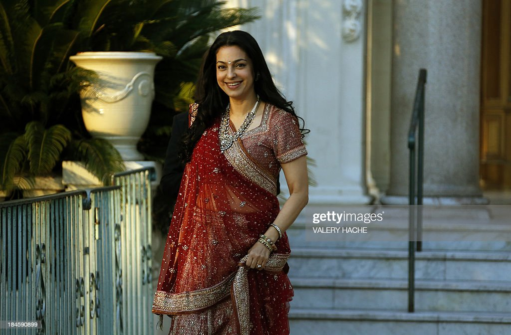Bollywood actress Juhi Chawla stands outside the Carlton Hotel in the southeastern French city of Cannes on October 14, 2013 during the wedding party of a London-based Indian couple. The Carlton palace was entirely booked for several nights to accomodate guests for the wedding of Grover and Ria Dubash.