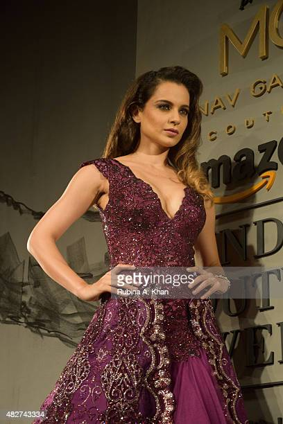 Bollywood actress Kangna Ranaut models designer Manav Gangwani's couture line on the fifth and final day of the Fashion Design Council of India's...
