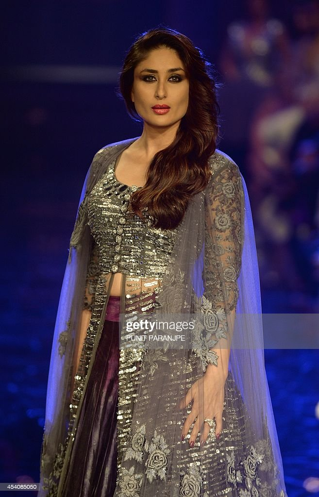 Bollywood actress Kareena Kapoor presents a creation by designer Manish Malhotra during the grand finale of Lakme Fashion Week (LFW) Winter/Festival 2014 in Mumbai on August 24, 2014.