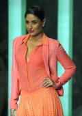 Bollywood actress Kareena Kapoor presents an outfit by designer Namrata Joshipura on March 26 2013 during the grand Finale of Lakme Fashion Week...
