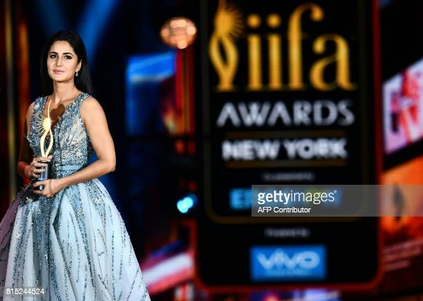 Bollywood Actress Katrina Kaif holds a trophy on stage during the IIFA Awards July 15 2017 at the MetLife Stadium in East Rutherford New Jersey...