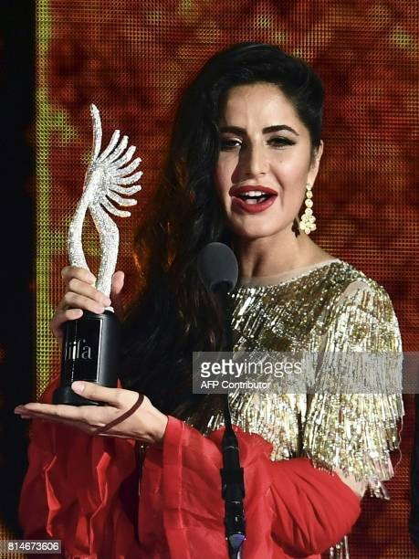 Bollywood Actress Katrina Kaif holds an award on stage during IIFA Rocks July 14 2017 at the MetLife Stadium in East Rutherford New Jersey during the...