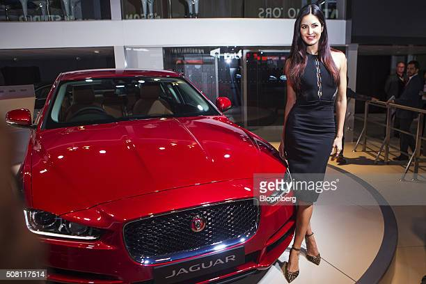 Bollywood actress Katrina Kaif poses with a Jaguar Land Rover Automotive Plc XE vehicle on display at the Auto Expo 2016 in Noida Uttar Pradesh India...