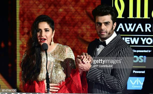 Bollywood actress Katrina Kaif speaks as actor Manish Paul holds her hand during IIFA Rocks part of the 18th International Indian Film Academy...