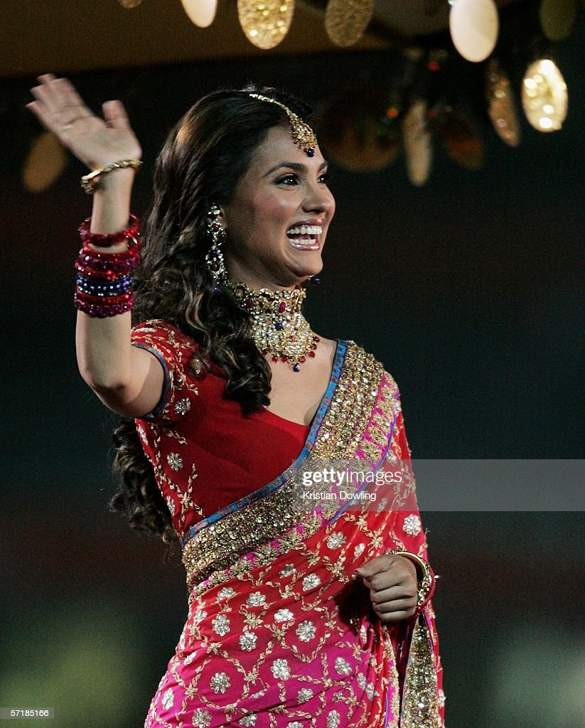 Bollywood actress Lara Dutta waves to the crowd during the Closing Ceremony for the Melbourne 2006 Commonwealth Games at the Melbourne Cricket Ground...