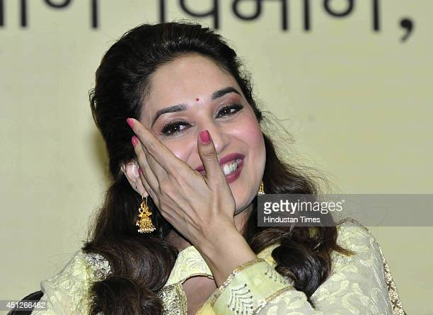 Bollywood actress Madhuri Dixit during the launch of a child rights campaign titled Mamta Abhiyan at Samanvay Bhawan on June 26 2014 in Bhopal India...