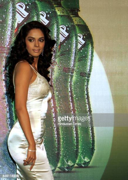 Bollywood actress Mallika Sherawat poses during a promotional event for a soft drink company at Taj Land's end