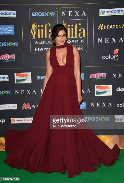 Bollywood Actress Nargis Fakhri arrives for the IIFA Awards July 15 2017 at the MetLife Stadium in East Rutherford New Jersey during the 18th...