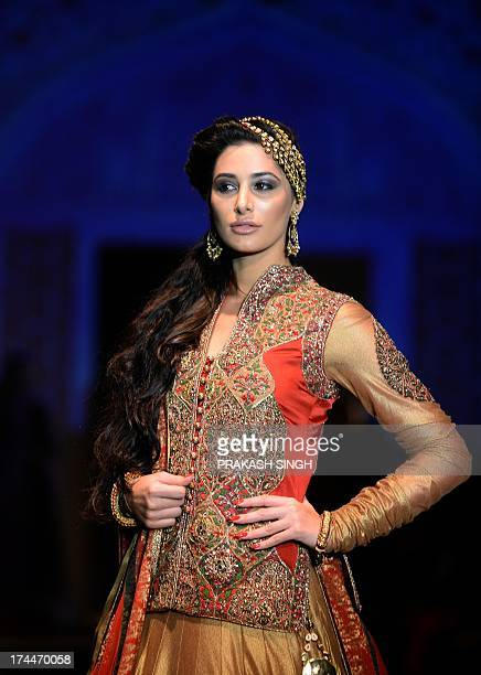 Bollywood Actress Nargis Fakhri shows creations by Fashion Designers Ashima and Leena during Indian Bridal Fashion Week in New Delhi July 262013...