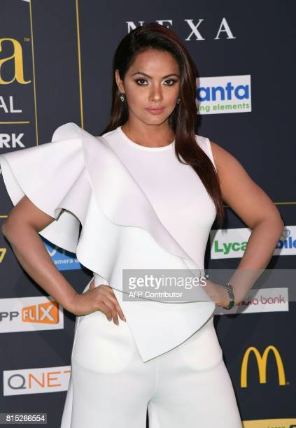 Bollywood actress Neetu Chandra arrives for the IIFA Awards July 15 2017 at the MetLife Stadium in East Rutherford New Jersey during the 18th...