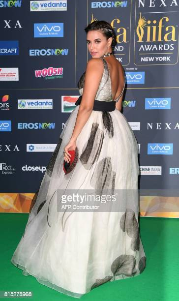 Bollywood Actress Neha Dhupia arrives for the IIFA Awards July 15 2017 at the MetLife Stadium in East Rutherford New Jersey during the 18th...