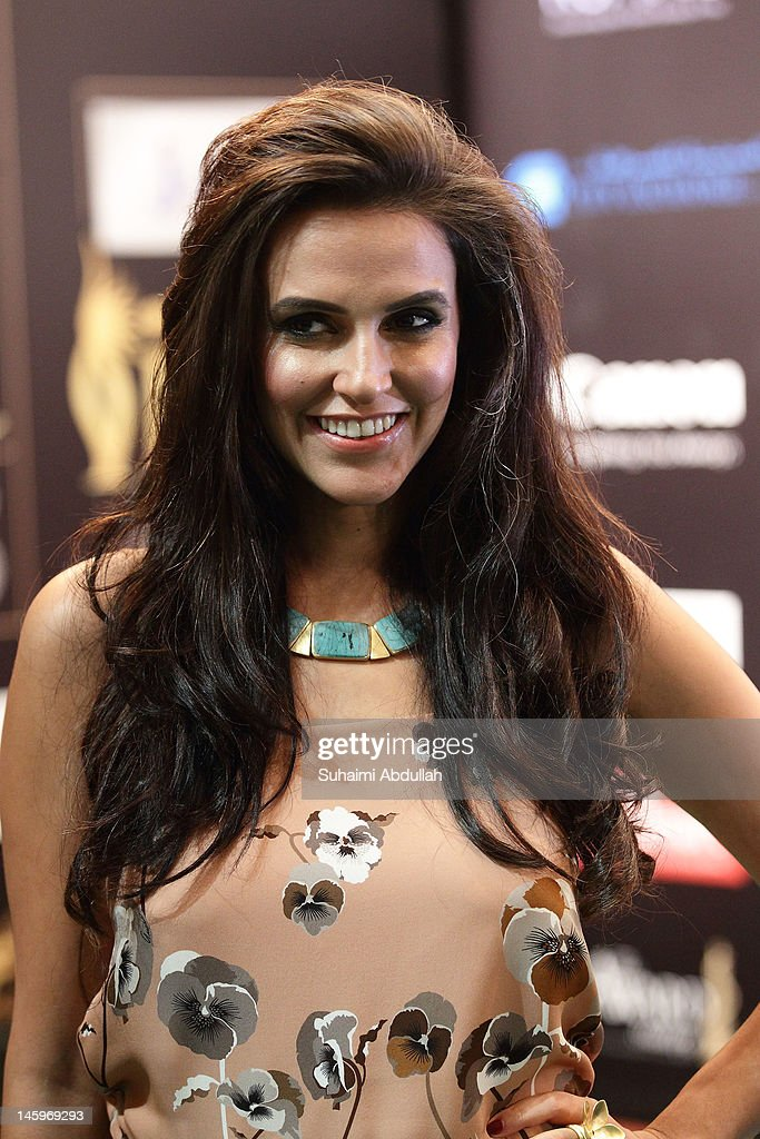 Bollywood actress <a gi-track='captionPersonalityLinkClicked' href=/galleries/search?phrase=Neha+Dhupia&family=editorial&specificpeople=2195000 ng-click='$event.stopPropagation()'>Neha Dhupia</a> poses on the green carpet during the IIFA Rocks Green Carpet on day two of the 2012 International India Film Academy Award weekend at the Esplanade on June 8, 2012 in Singapore.