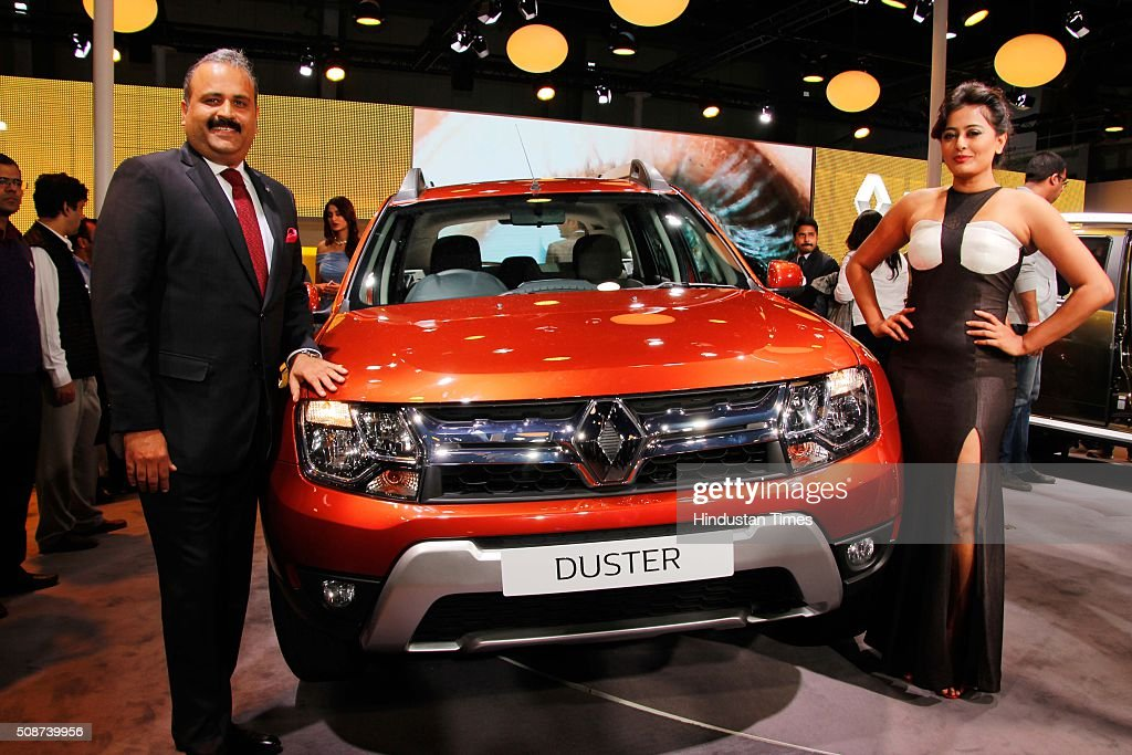 Bollywood actress Nidhi Subbaiah (R) with Sumit Sawhney, country CEO and MD, Renault India during the launch of new Renault Duster at the Auto Expo 2016, on February 4, 2016 in Greater Noida, India. The 13th edition of the Delhi Auto Expo kicked off at the India Expo Mart (IEM) in Greater Noida with brands from over 20 countries showcasing various cars, bikes and automobile trends. India, the worlds fifth biggest auto market, has an extremely low number of cars for its 1.2 billion people, with industry figures suggesting there are as few as 16 per 1,000 people