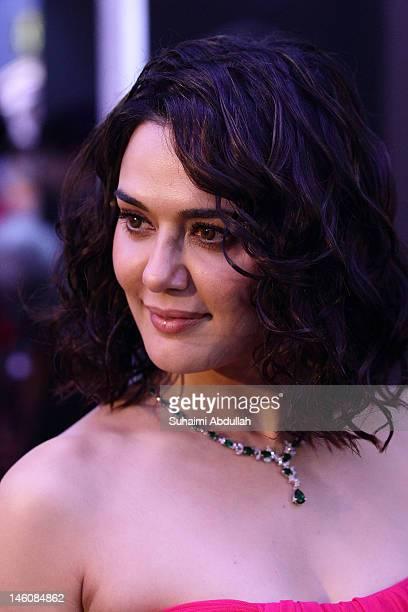 Bollywood actress Preity Zinta poses at the IIFA green carpet event at the 2012 International India Film Academy Awards at the Singapore Indoor...