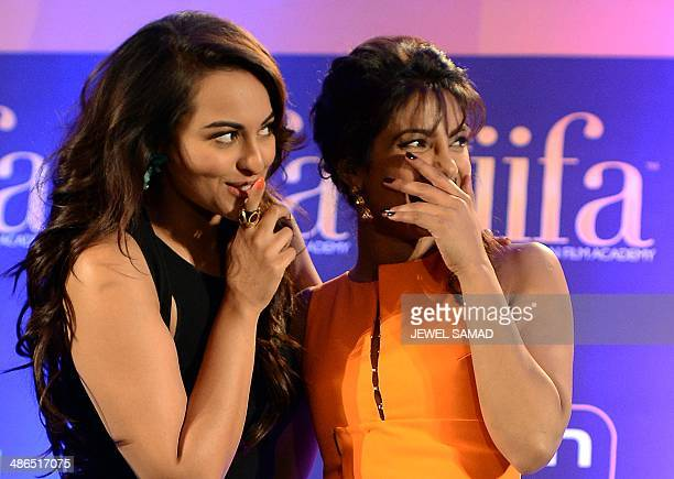 Bollywood actress Priyanka Chopra and Nominee for Best Performance in a Leading Role Bollywood actress Sonakshi Sinha laugh as Bollywood star Anil...