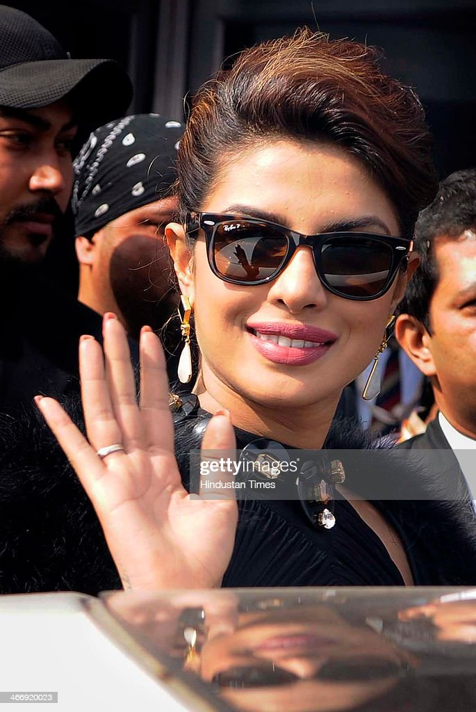 Bollywood actress Priyanka Chopra waving to crowd after coming out from Jaguar showroom during the first day of 12th Auto Expo at India Expo Mart on February 5, 2014 in Greater Noida, India.