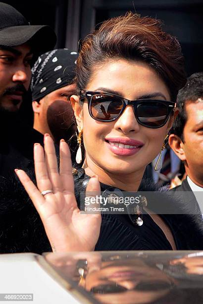 Bollywood actress Priyanka Chopra waving to crowd after coming out from Jaguar showroom during the first day of 12th Auto Expo at India Expo Mart on...