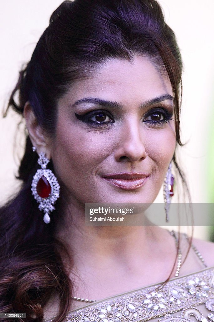 Bollywood actress <a gi-track='captionPersonalityLinkClicked' href=/galleries/search?phrase=Raveena+Tandon&family=editorial&specificpeople=3007225 ng-click='$event.stopPropagation()'>Raveena Tandon</a> poses at the IIFA awards green carpet event at the 2012 International India Film Academy Awards at the Singapore Indoor Stadium on June 9, 2012 in Singapore.