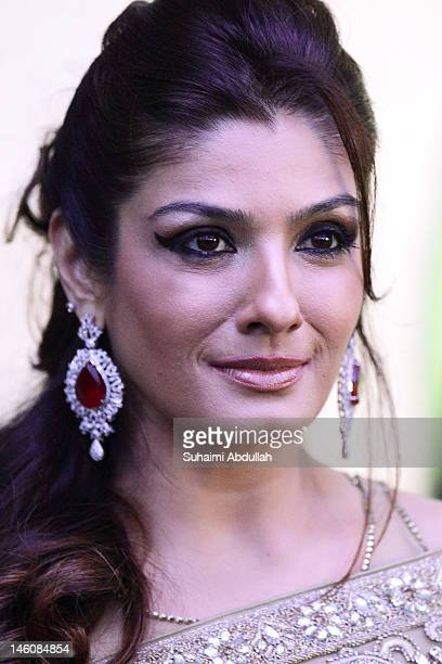 Bollywood actress Raveena Tandon poses at the IIFA awards green carpet event at the 2012 International India Film Academy Awards at the Singapore...