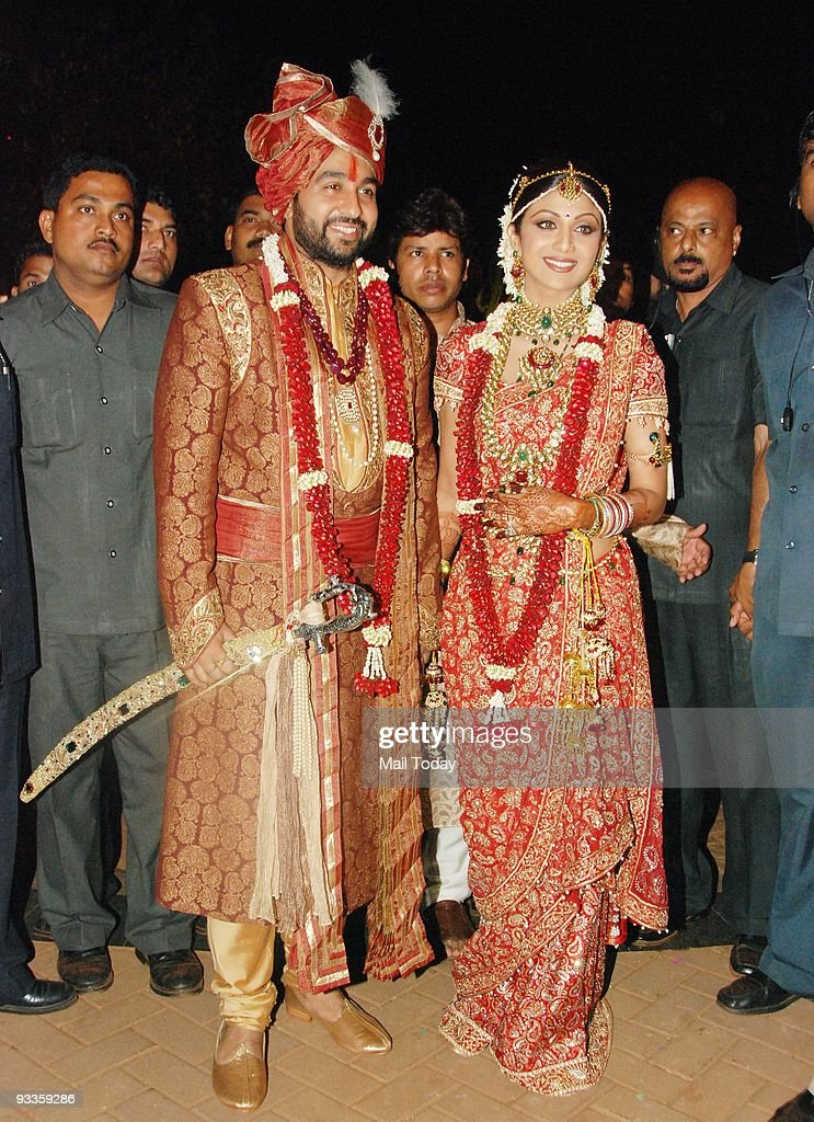 Bollywood actress Shilpa Shetty right and London based businessman Raj Kundra pose for the media after their marriage ceremony in Khandala around 110...