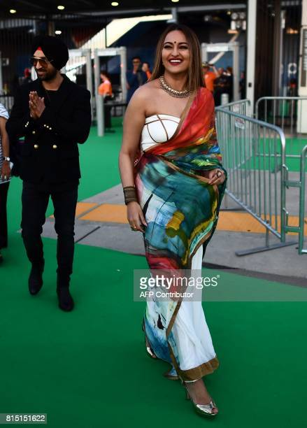 Bollywood actress Sonakshi Sinha and actor/singer Diljit Dosanjh arrive for the IIFA Awards of the 18th International Indian Film Academy Festival at...