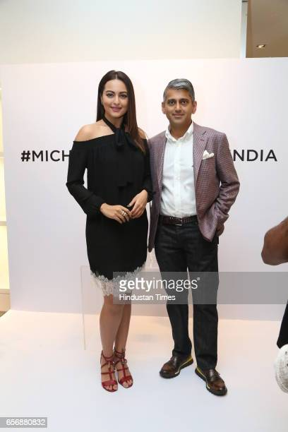 Bollywood actress Sonakshi Sinha and Sanjay Kapoor during an event at Michael Kors store at DLF Emporio Mall on March 20 2017 in New Delhi India