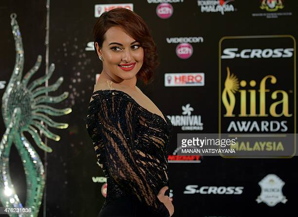 Bollywood actress Sonakshi Sinha poses on the green carpet as she arrives to attend the final day of the 16th International Indian Film Academy...